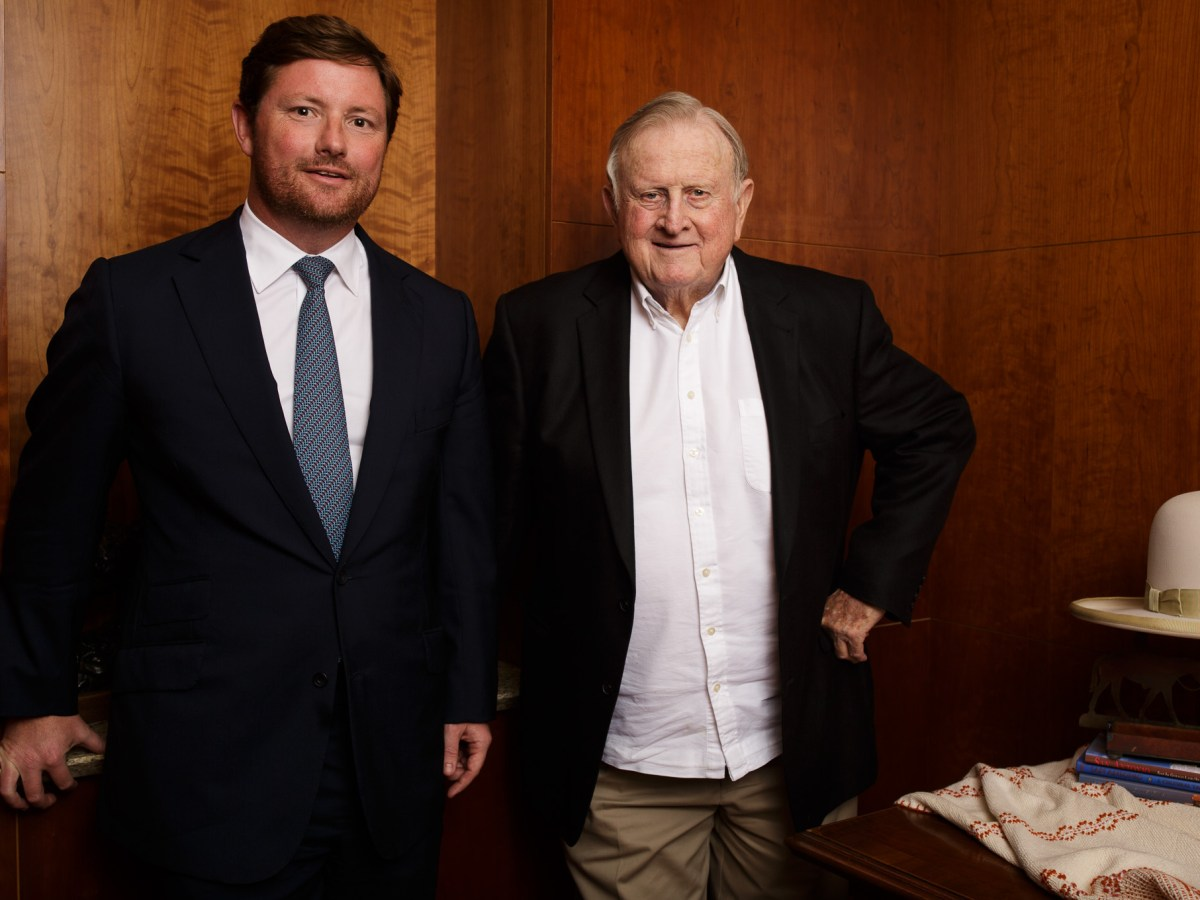 (From left) Rad Weaver and Red McCombs stand for a portrait at McCombs Enterprises.
