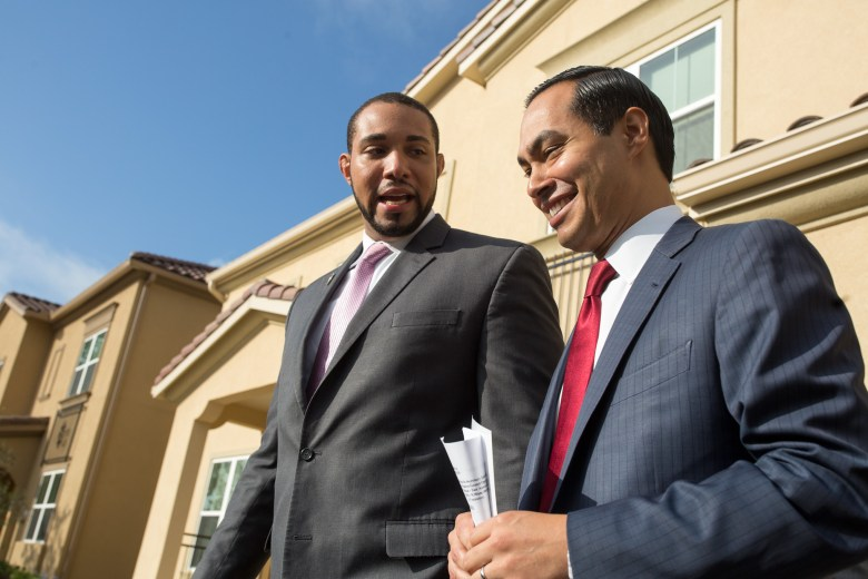 Precinct 4 Bexar County Commissioner Tommy Calvert and U.S. Secretary of Housing and Urban Development Julián Castro talk after a tour of model homes at Wheatley Meadows.