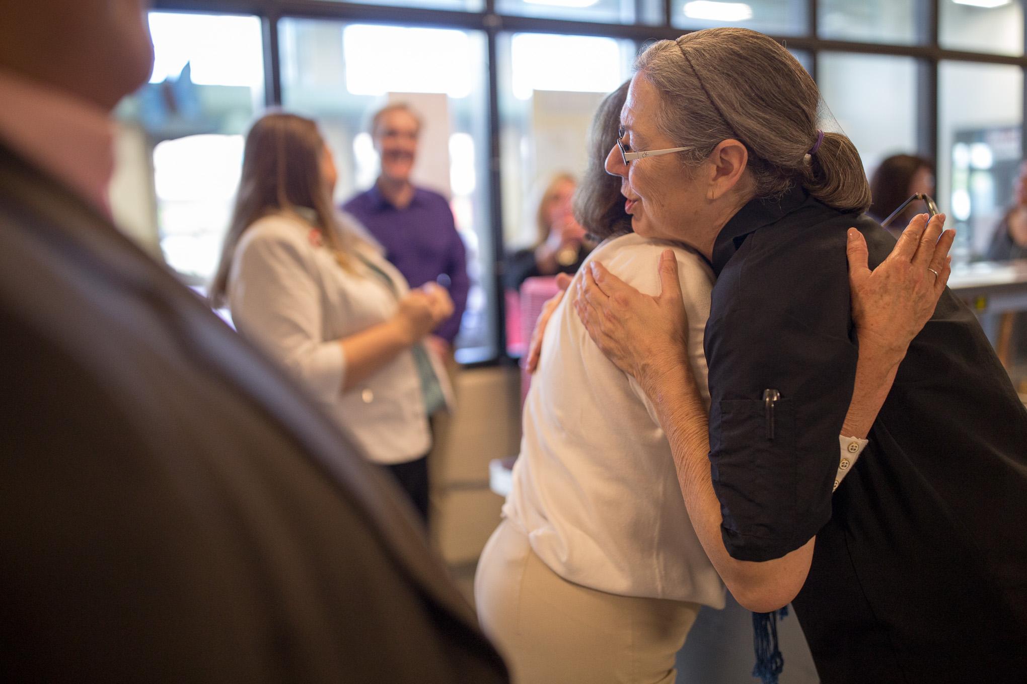 Patricia Barnes hugs Haven For Hub Volunteer Coordinator Rebecca Sorrells during a tour of the facilities.
