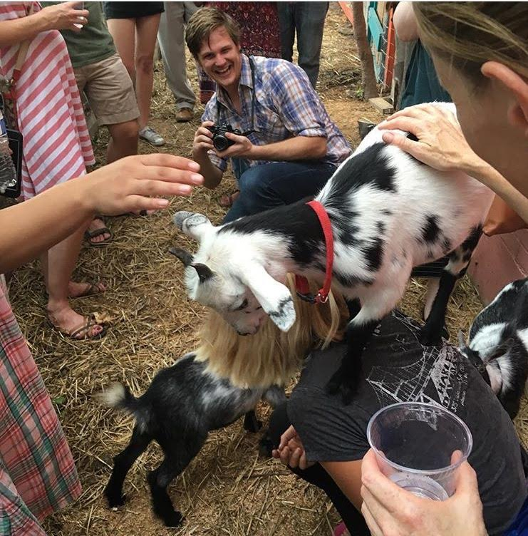 Students have some fun with the Nigerian Dwarf Goats after attending a fermentation workshop on the farm.
