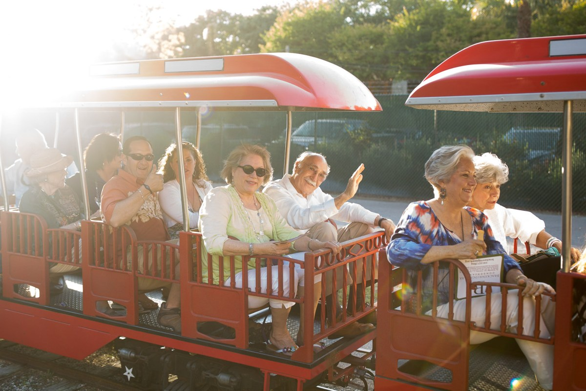 Guests ride the Brackenridge Park train for the purpose of taking a tour of the park itself by rail during an event hosted by the Brackenridge Park Conservancy earlier this year. Photo by Scott Ball.