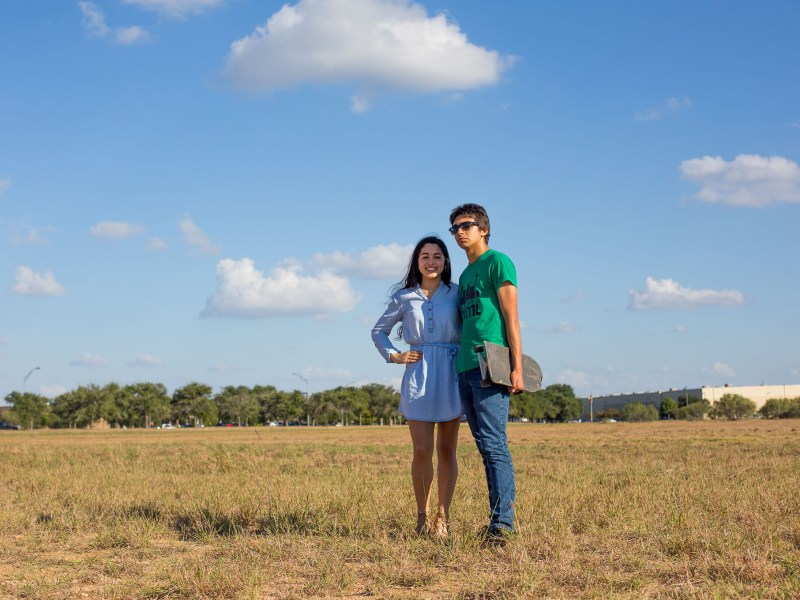 Maria Victoria Alonso Arroyo and her brother Andy stand in the empty field where Maria would like to see the City build a skatepark.