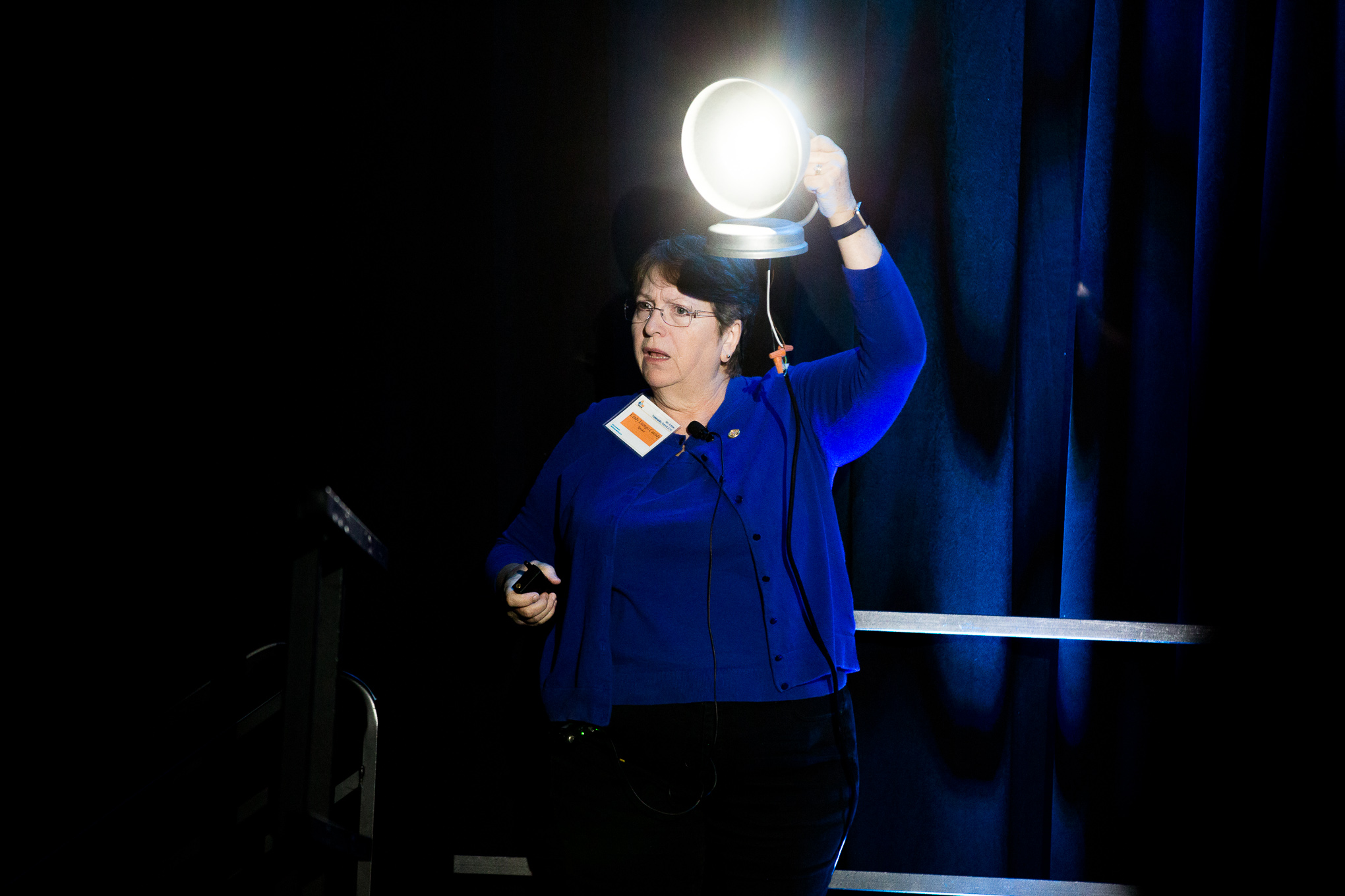 Texas Section Leader of International Dark-Sky Association Cindy Luongo Cassidy demonstrates how directing light is more efficient.