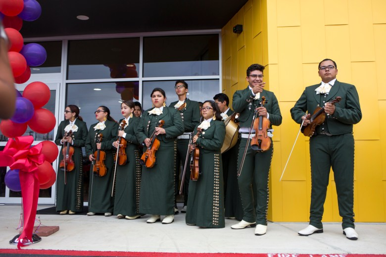 Oliver Wendell Holmes High School mariachi band wait for the ribbon cutting.