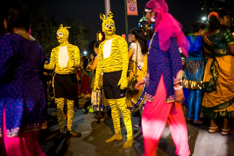 Dancers dress as animals as part of a traditional danced featured in the Diwali Festival.