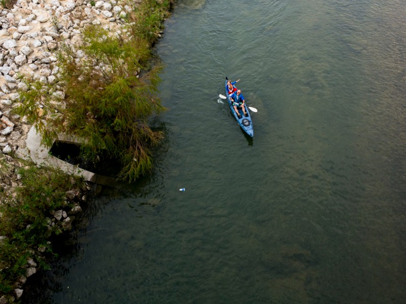 A father and son kayak down the San Antonio River as part of the The River Relay & Get Outdoors 5K.