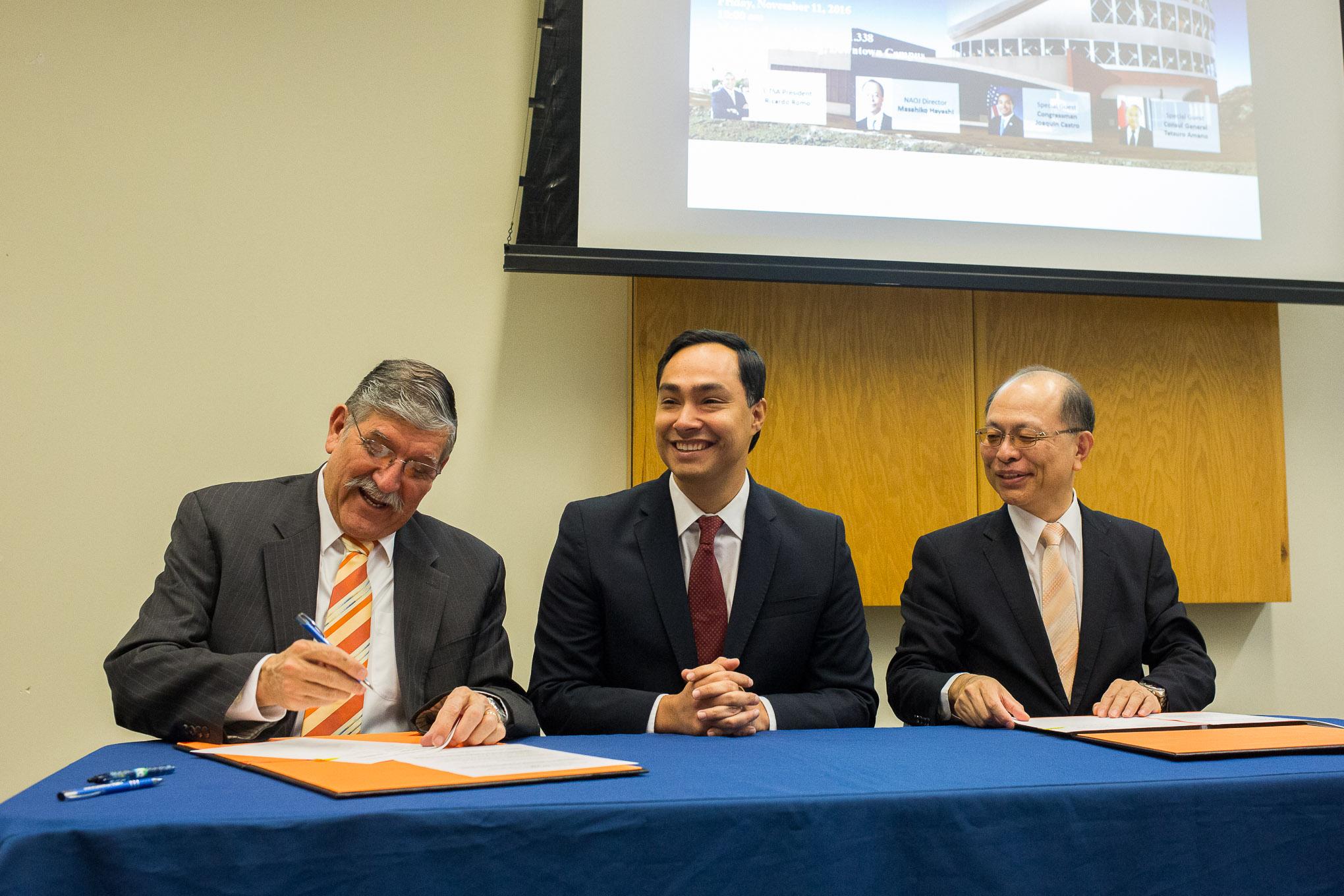 From left: UTSA President Ricardo Romo, Congressman Joaquin Castro, and NAOJ Director Masahiko Hayashi sign an agreement to collaborate with Japan on astronomy.