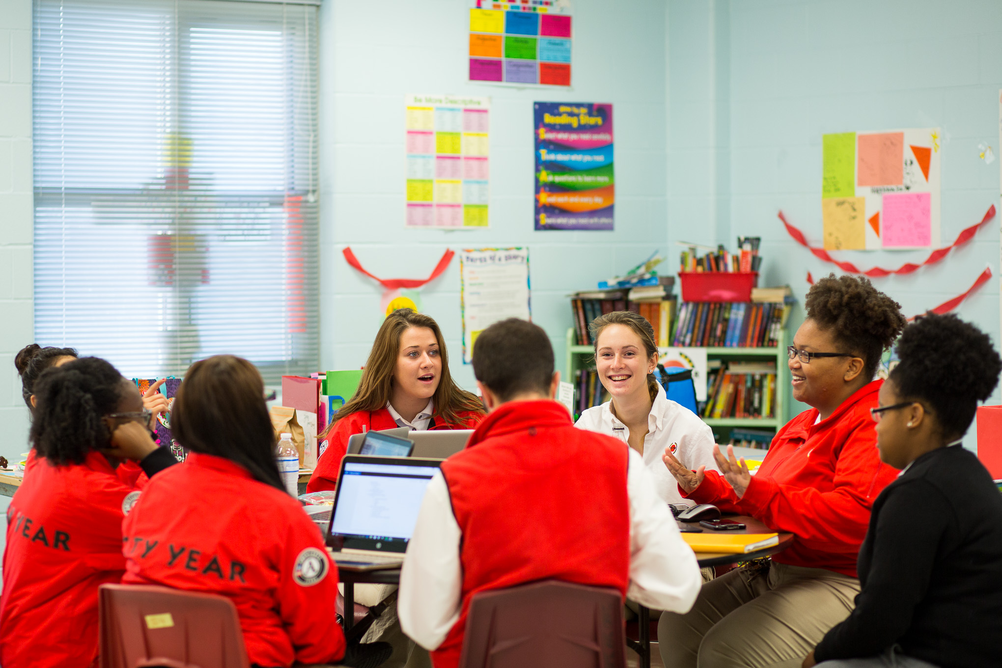 Davis Middle School City Year team members meet for a morning meeting before school starts.