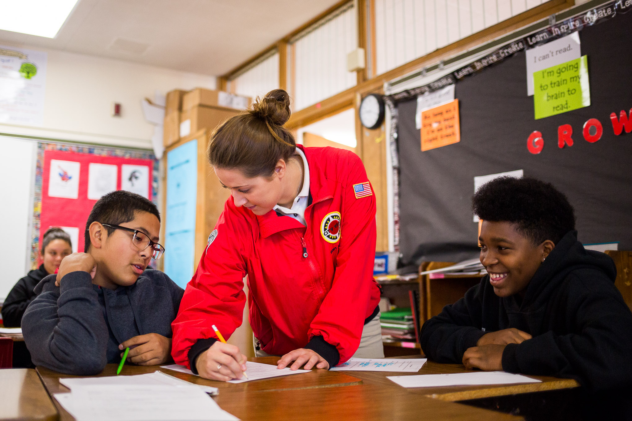 Jessica Rieger works with students during an English class.