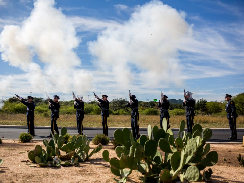 A 21 gun salute is done in honor of Detective Marconi.