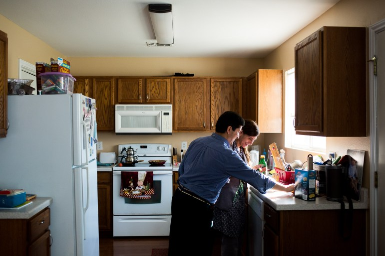 Beytullah and Gabriella Colak cook together in their kitchen.