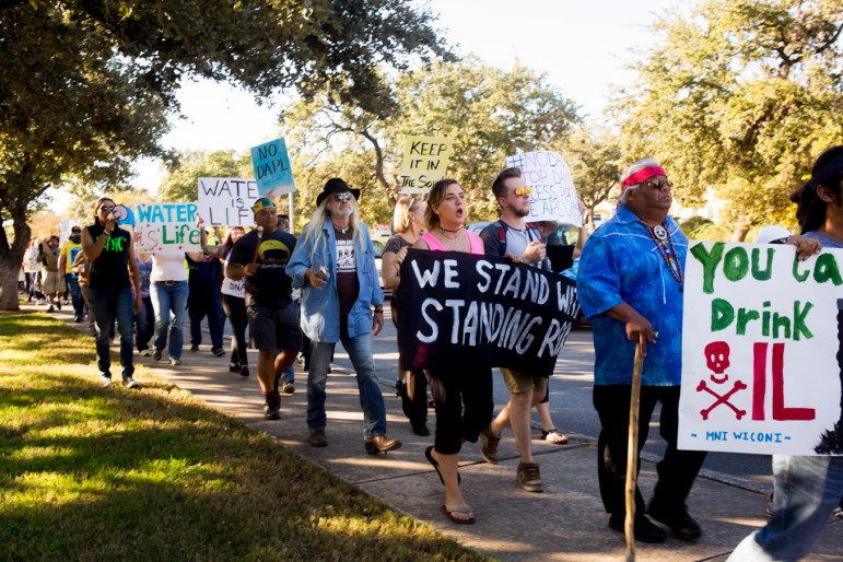People march in protest of Texas company Energy Transfer Partners' perceived disregard for environmental concerns.