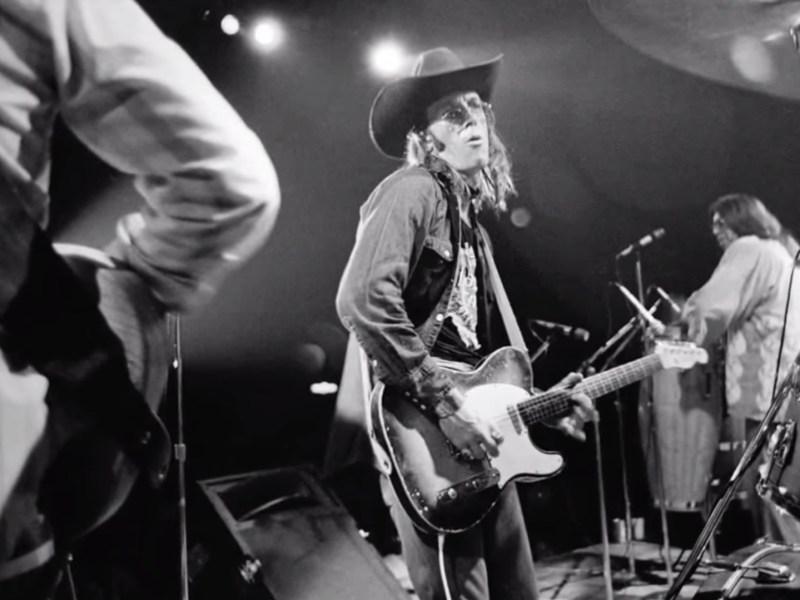 A screenshot of Doug Sahm performing from the documentary Sir Doug and the Genuine Texas Cosmic Groove.