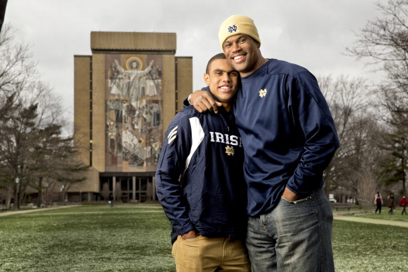 College Football: Portrait of former Notre Dame Wide Receiver Corey Robinson and his father, former NBA basketball player with the San Antonio Spurs, David Robinson during a photo shoot in front of Hesburgh Library on the ND campus.