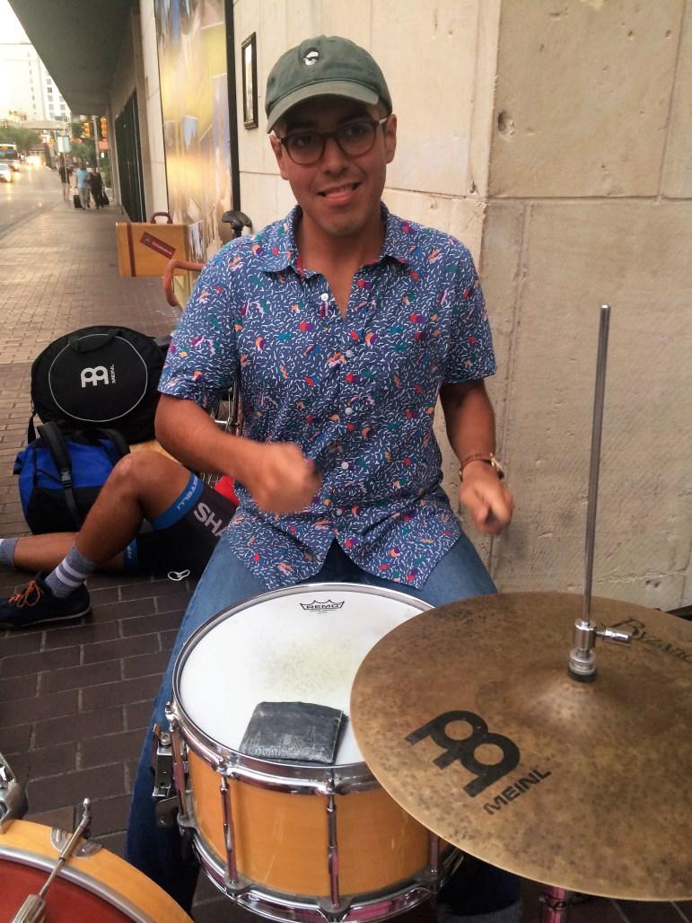 Julian Anthony performs on the corner of Houston and Navarro. Photo courtesy of Adam Tutor