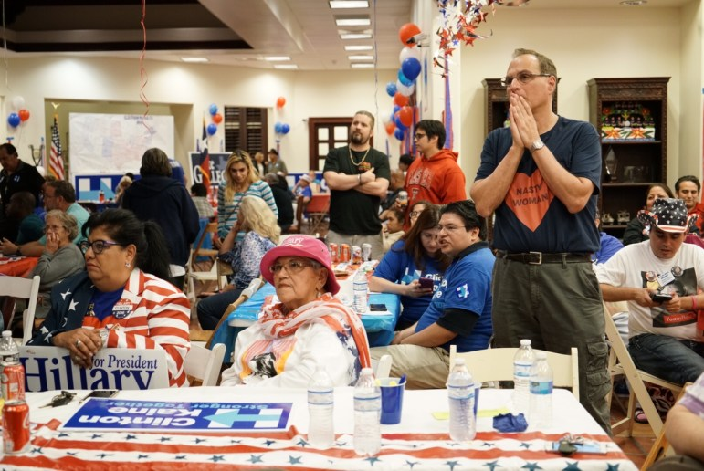 Clinton supporters show concern as election results continue to come in.