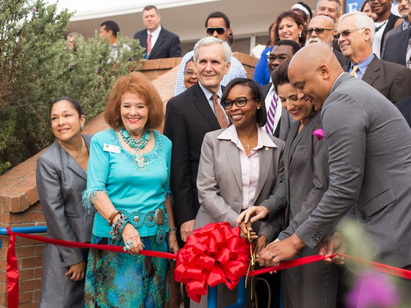 Public officials including Mayor Ivy Taylor, Assistant City Manager Lori Houston, Councilman Alan Warrick (D2), and U.S. Rep. Lloyd Doggett (D-Texas) cut a ribbon opening the Eastside Education and Training Center.