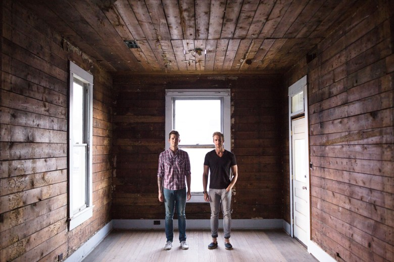 Jean-Luc and Maxim Mette stand in the empty house that they will transform into a bar.