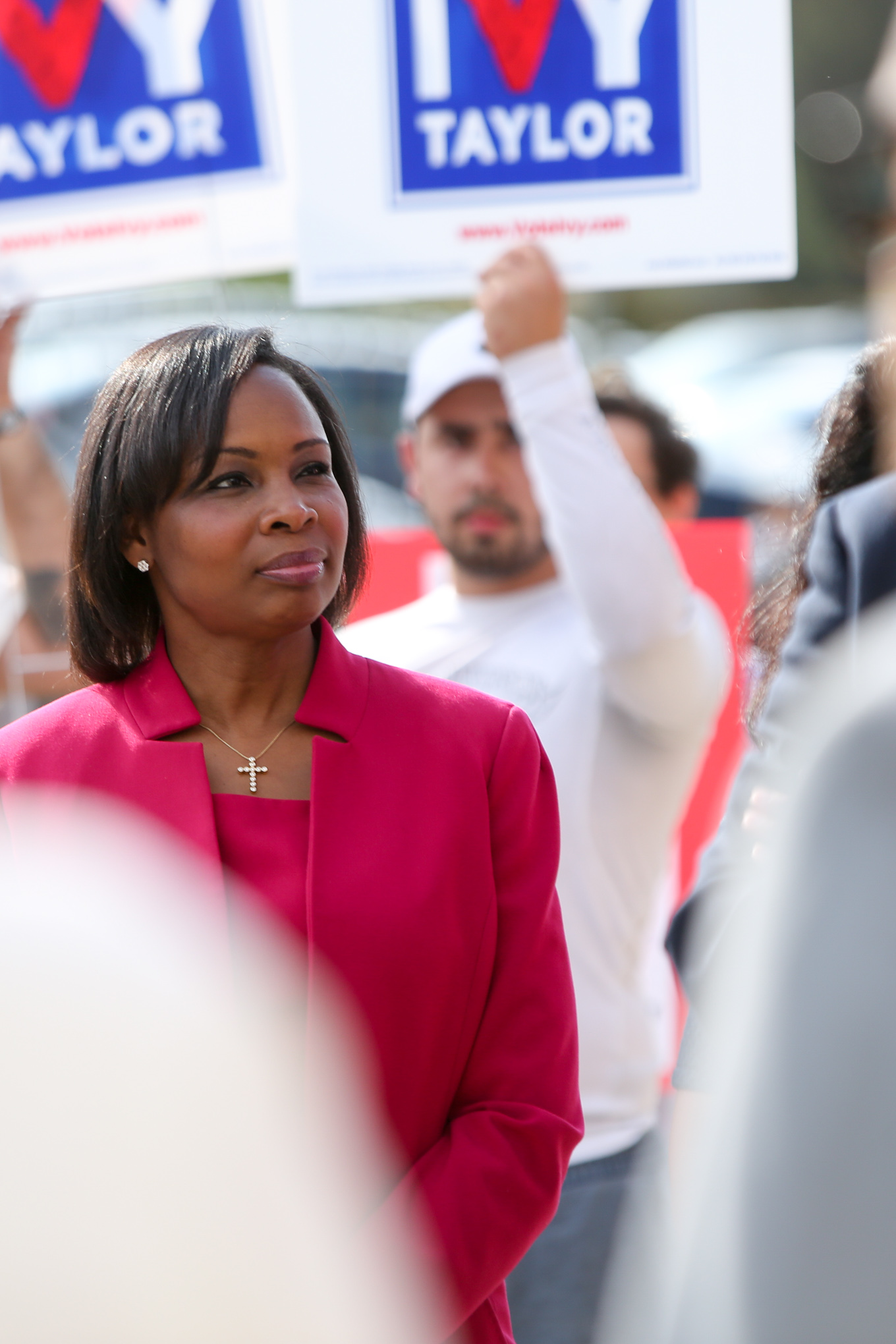 """Mayor Ivy Taylor looks to Esperanza """"Hope"""" Andrade as she speaks to her."""