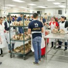 Over 50 volunteers fill the industrial kitchen at the Henry B. Gonzalez Convention Center in preparation of the 37th annual Raul Jimenez Thanksgiving Dinner.
