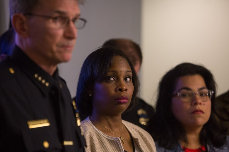Mayor Ivy Taylor looks up at Police Chief William McManus during a press conference following the death of San Antonio Police Department Officer Benjamin Marconi.
