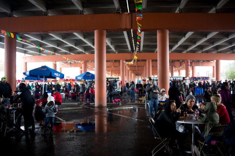 Thousands of people gathered under the Pearl parking lot for the Tamale Festival despite the rain.