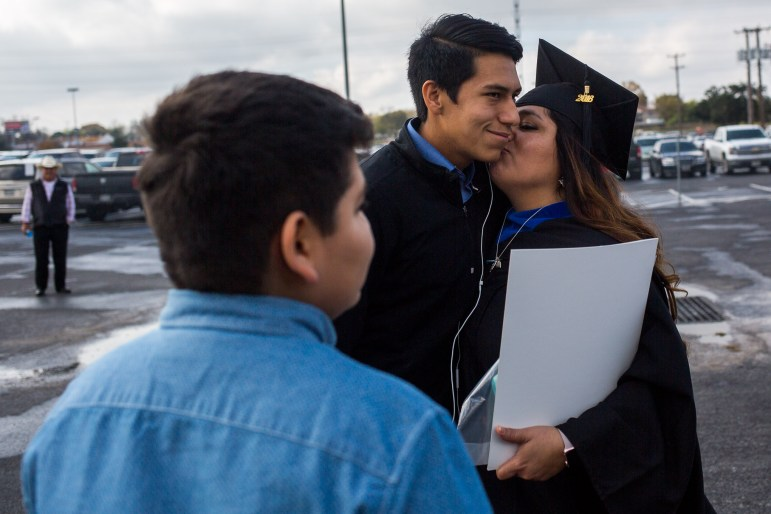 Gina García gives her oldest son Nomar García Ybarra a kiss after graduating.