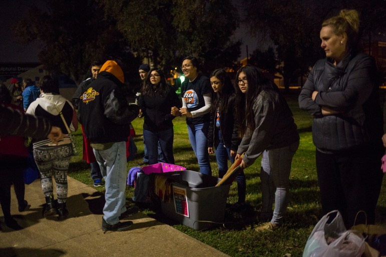 Advanced Learning Academy students pull out scarves and blankets to give out to San Antonio's homeless population.