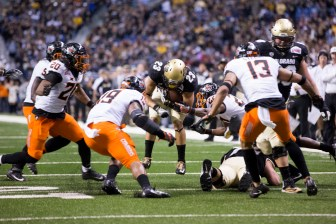 Colorado Buffaloes running back Phillip Lindsay tries to break through the Oklahoma State defense.