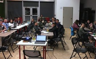 Participants at a past Dinner and Code meetup learn about coding and programming in an encouraging setting in the Geekdom Event Center.