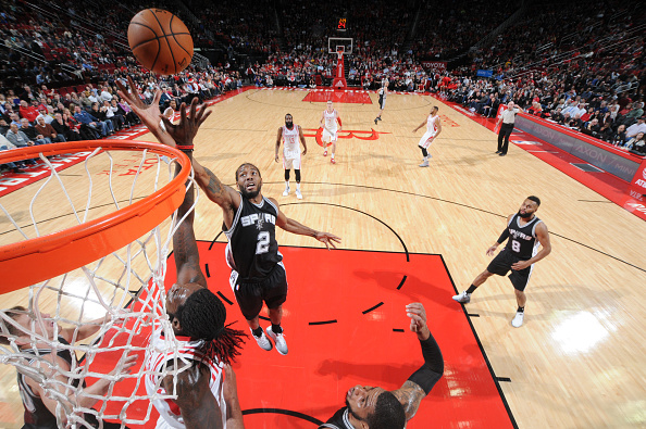 Kawhi Leonard #2 of the San Antonio Spurs shoots the ball against the Houston Rockets during the game on at the Toyota Center in Houston, Texas.