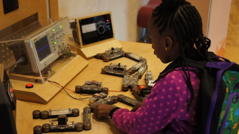 An SAISD student uses the robotics equipment at the Hill Country Science Mill.