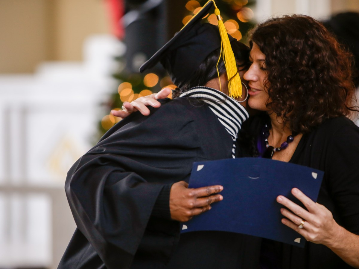 After receiving her certificate, Esperanza Court graduate Amy embraces with 144th District Court Judge Lorina Rummel, who oversee's Esperanza Court.