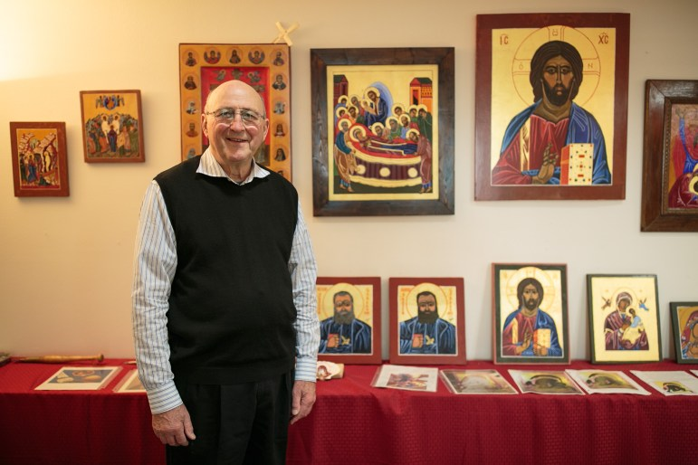 Fr. Clyde Rausch stands by a small amount of his work in his studio at the Oblate Renewal Center.
