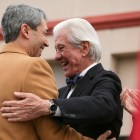 Ron Nirenberg and Lionel Sosa embrace on stage.