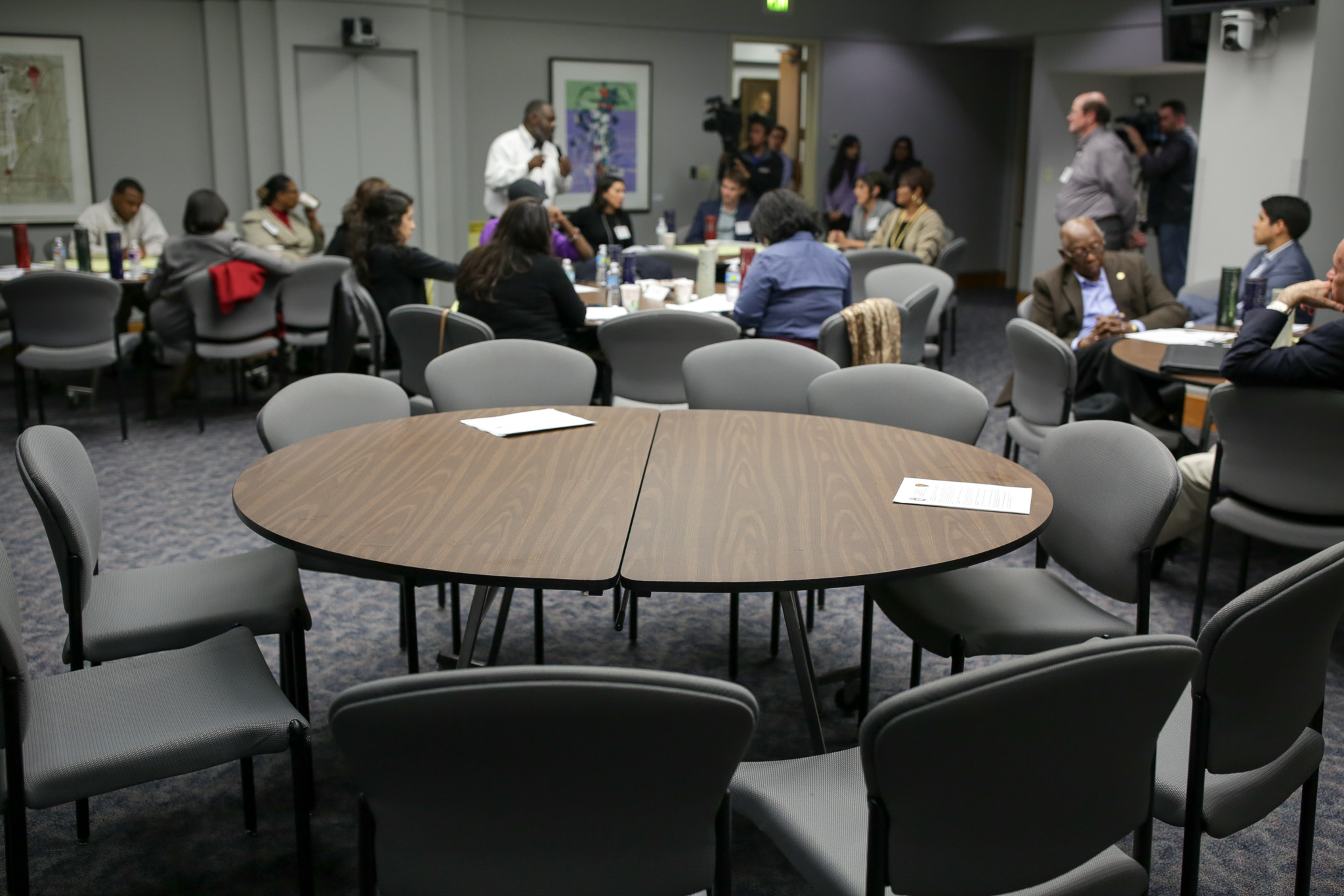 The session included many absent appointees leaving empty chairs throughout the room.