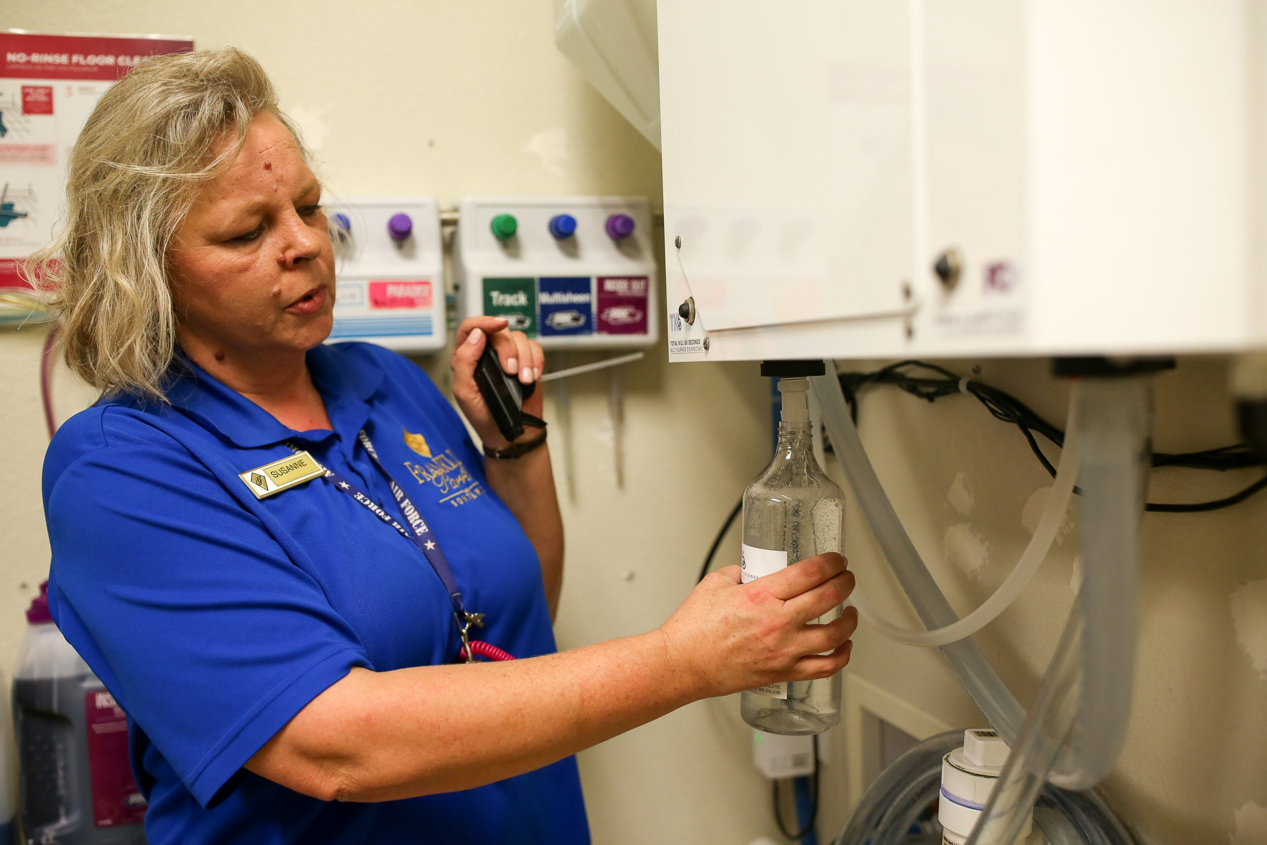 Franklin Park Housekeeping Supervisor Susanne Hutchinson fill a cleaning bottle with R-Water using a press of a button.