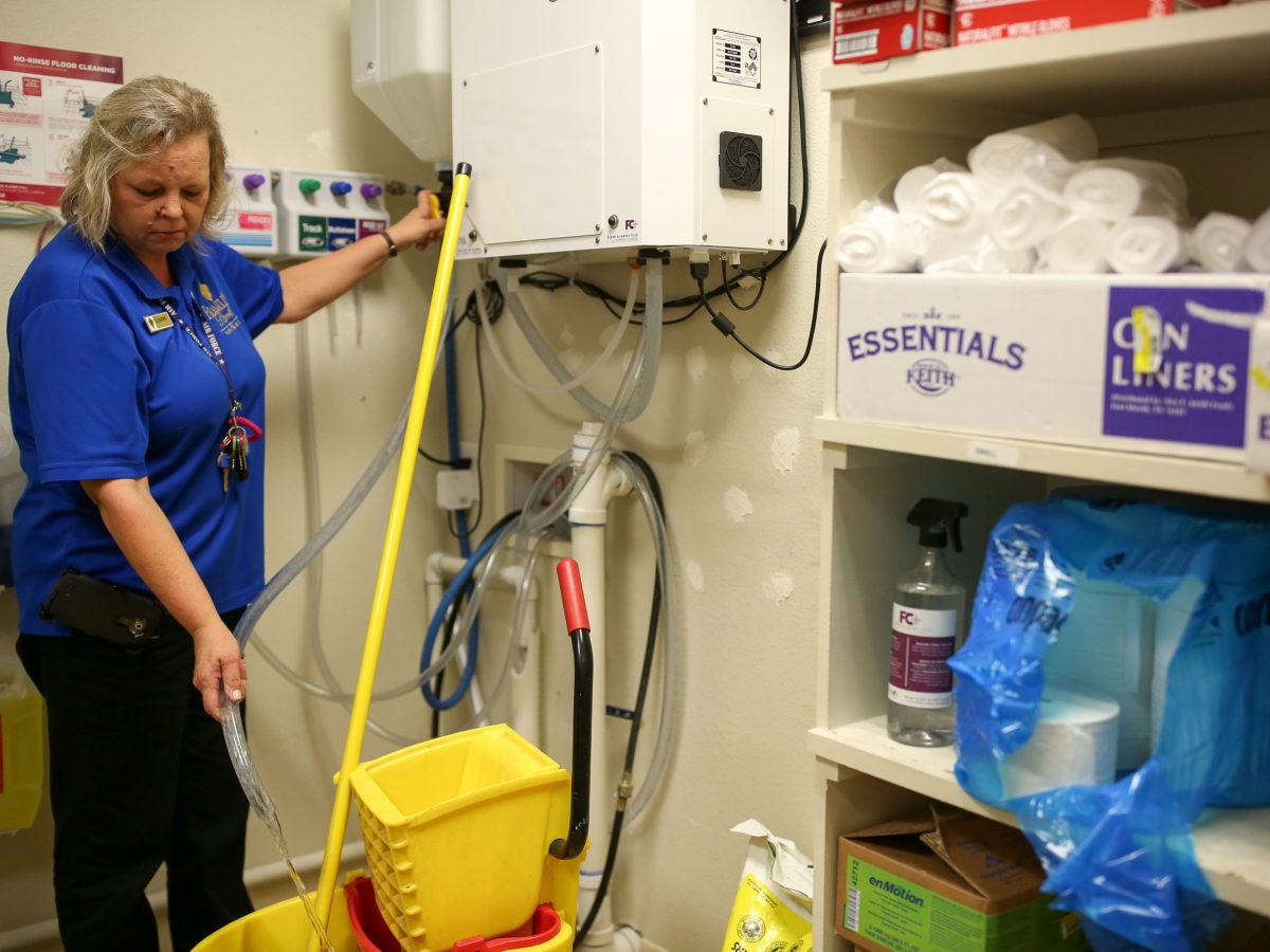 Franklin Park Housekeeping Supervisor Susanne Hutchinson fills her mop bucket with an R-Water solution.