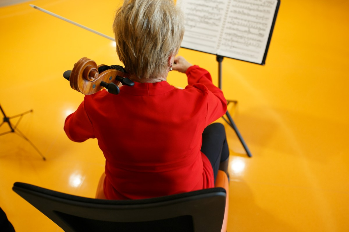 Cellist Linda Verner performs with fellow musicians on the ninth floor of Children's Hospital of San Antonio.