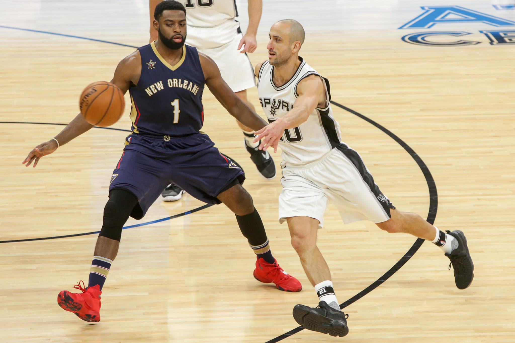 Spurs Guard #20 Manu Ginobili dishes the ball on the run.