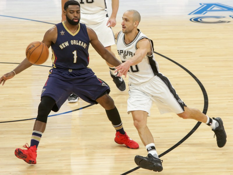 Spurs Guard #20 Manu Ginobili dishes the ball on the run.