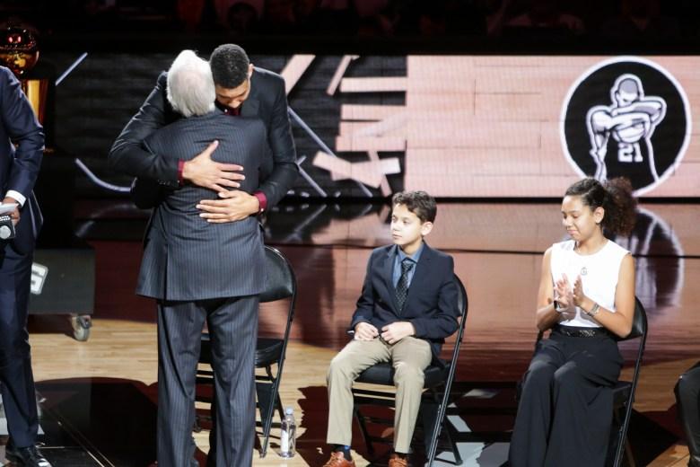 Tim Duncan hugs Coach Gregg Popovich following his speech.