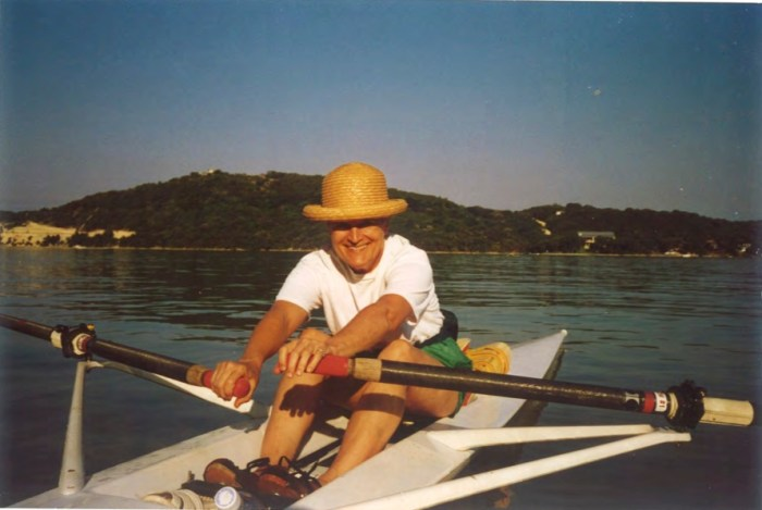 Emily Thuss rowing a boat on Medina Lake.