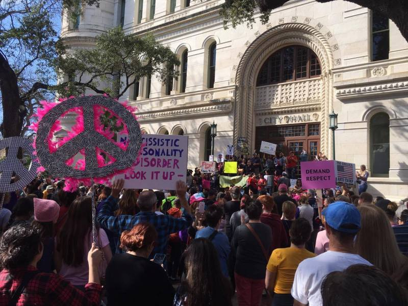 Women and supporters of women's rights collect in front of San Antonio City Hall on Saturday.