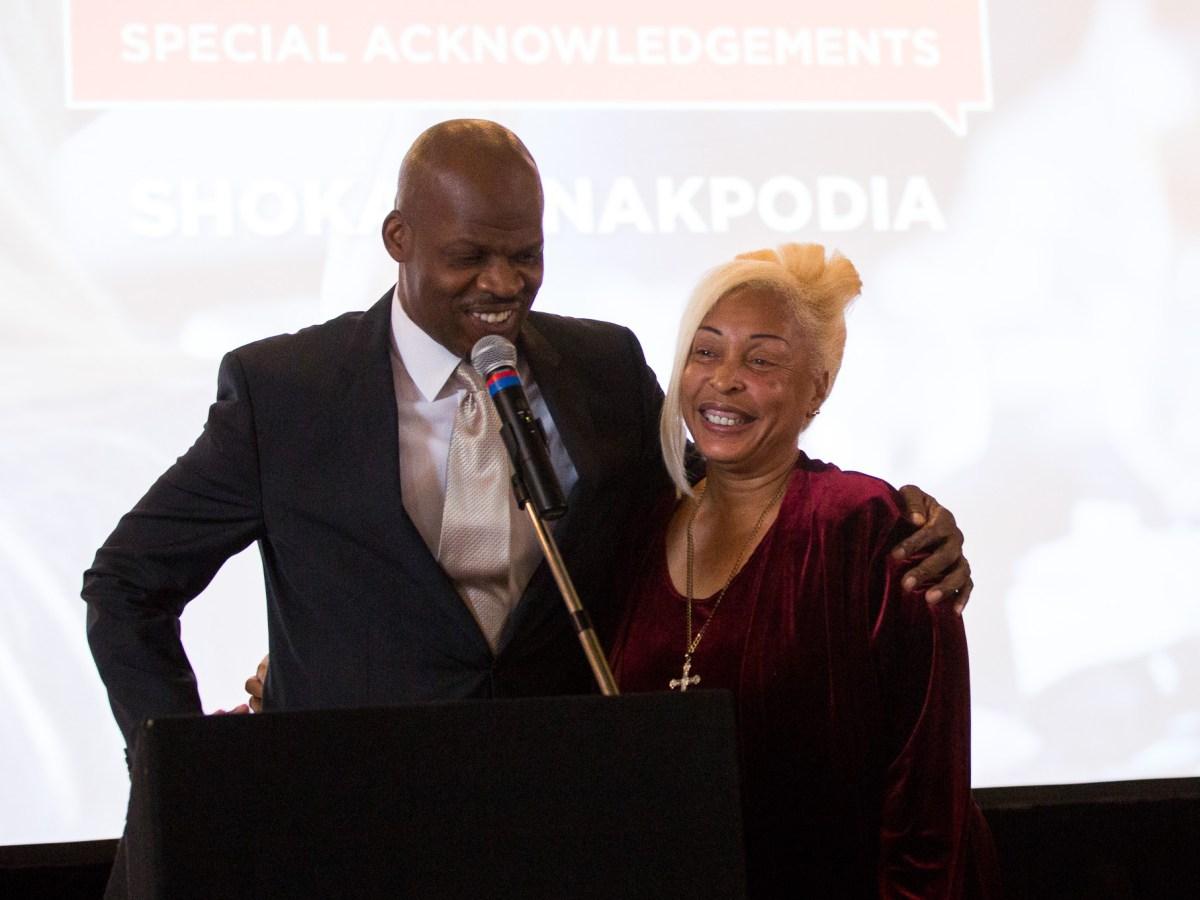 DreamVoice President Shokare Nakpodia embraces Bishop Rosa Wilson of the MLK Commission.