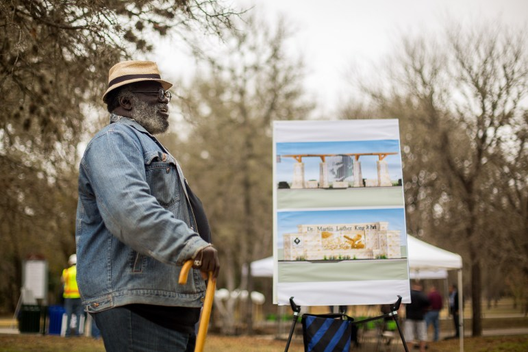 , a lifelong resident of the Eastside, looks at the renderings of the new MLK monuments for the park.