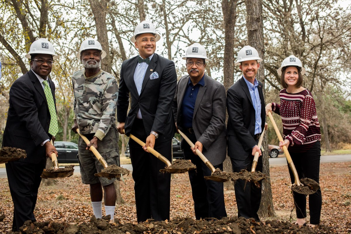 Speakers from the day's ceremony break ground on the construction for Martin Luther King Park.