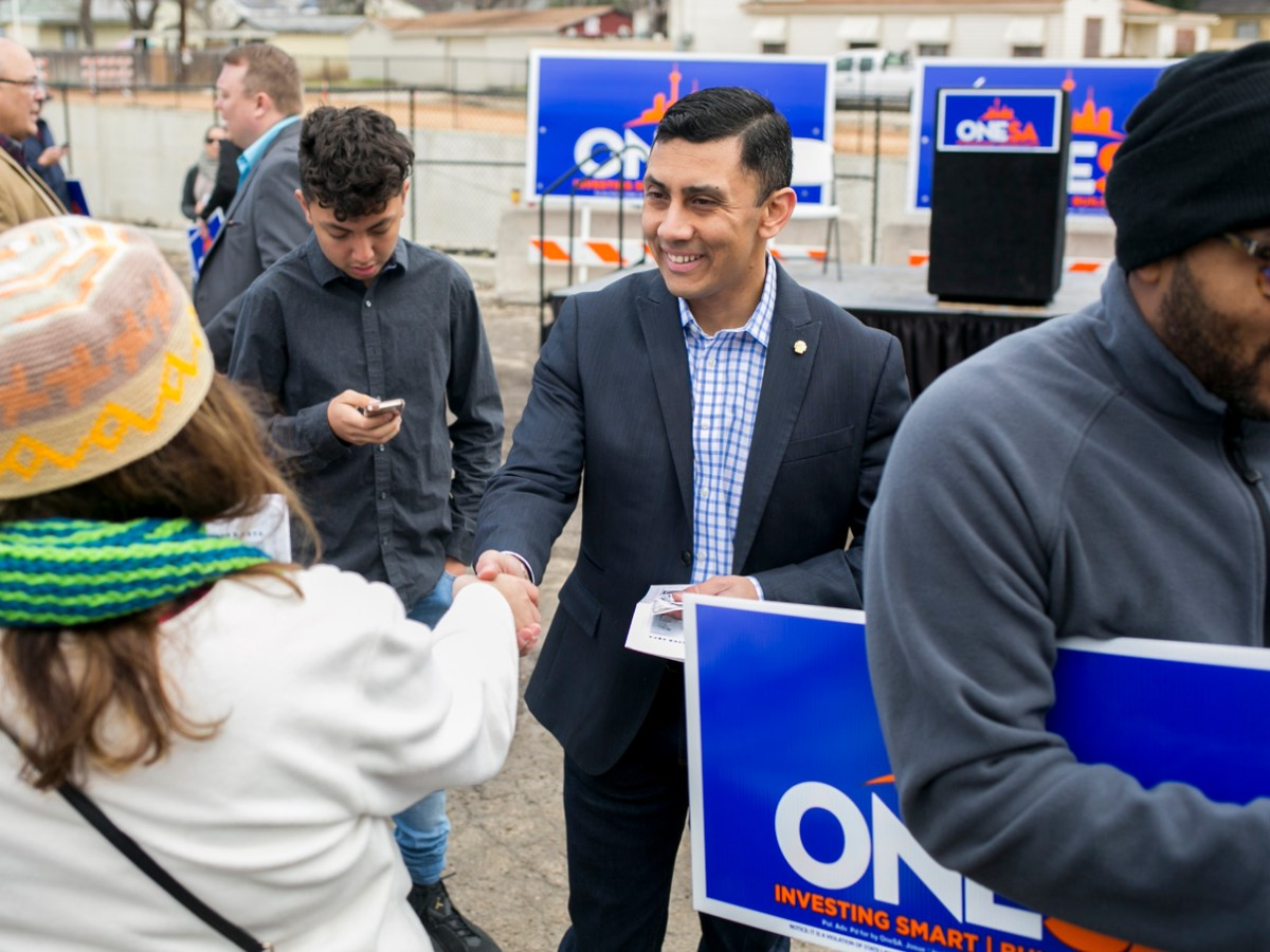 Councilman Cris Medina (D7) greets members of the community at the OneSA bond campaign launch.