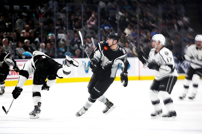 San Antonio Rampage forward A.J. Greer dodges a kick during a game against the Ontario Reign.