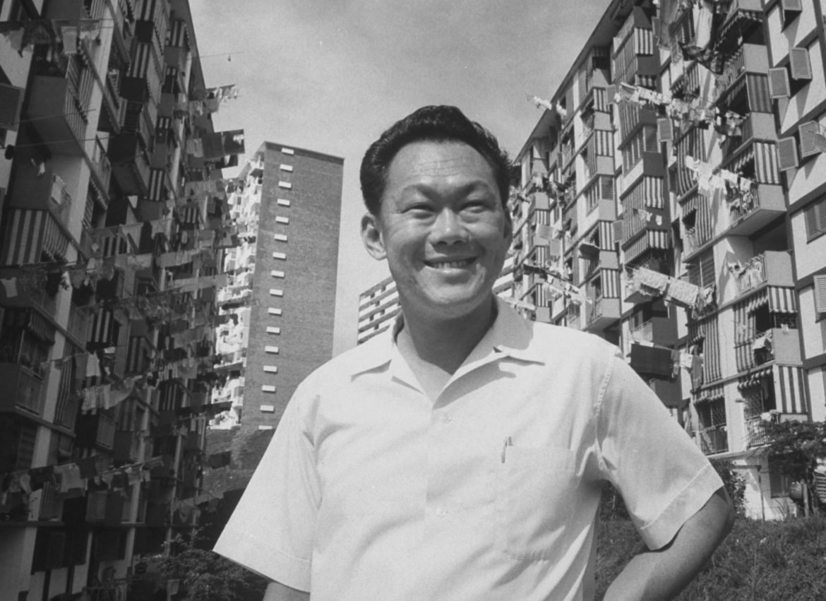 Prime Minister Kuan Yew Lee visiting housing project.